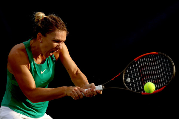 Halep crushes a backhand during her quarterfinal win. Photo; Matthew Stockman/Getty Images