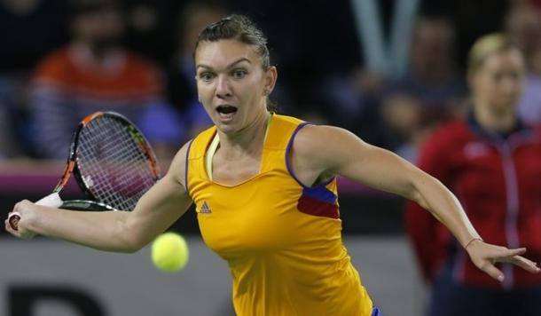 Simona Halep plays a forehand during Romania's first round loss. Photo: Fed Cup