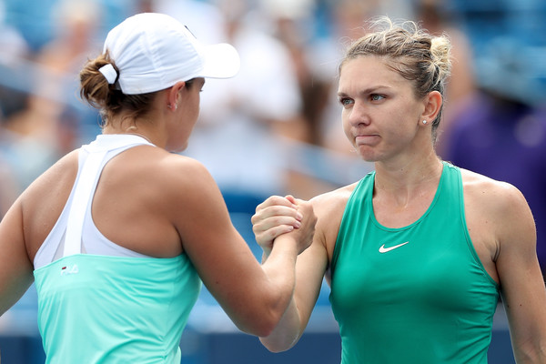 Halep and Ashleigh Barty (left) shake hands after their third-round meeting. Photo: Matthew Stockman/Getty Images