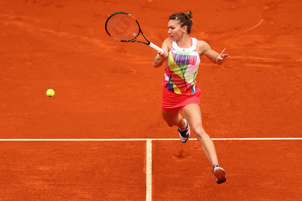 Simona Halep leaps into a forehand during her quarterfinal. Photo: Julian Finney/Getty Images