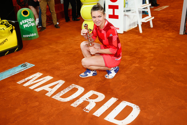 Simona Halep poses with her trophy after winning in Madrid. Photo: Julian Finney/Getty Images