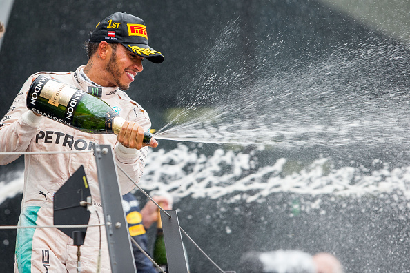 Hamilton celebrates after overtaking in the final lap | Photo: Peter J Fox/Getty Images Sport