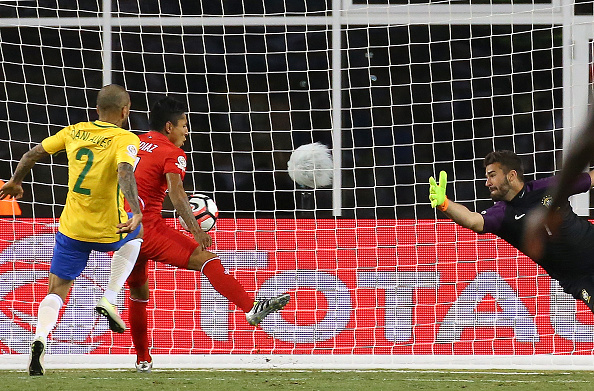 Peru's Raul Ruidiaz handles the ball into the net against Brazil. (Getty)