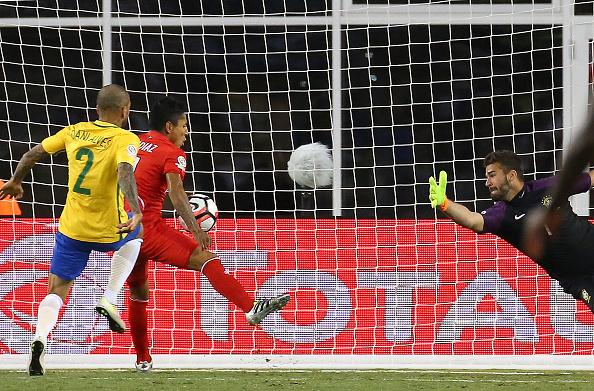 Peru's Raul Ruidiaz handles the ball into the net against Brazil. (Getty)
