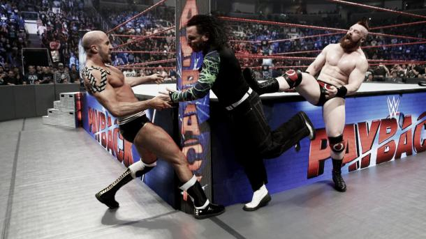 The champions suffered a post-match beat down. Photo- WWE.com