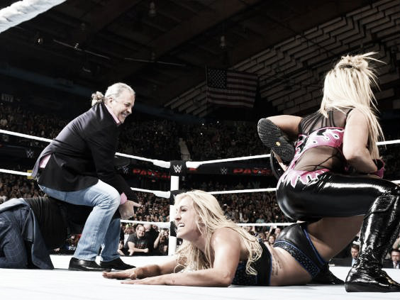 Hart and Natalya both lock in the submission move side by side (image: independent.co.uk)