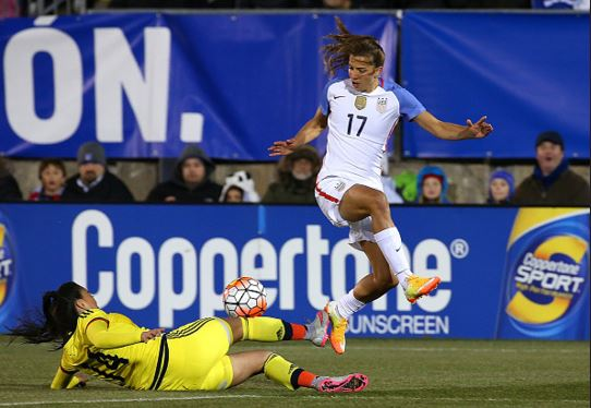Tobin Heath (air) of the United States leaps over Nataly Arias (ground) of Colombia during an international friendly soccer match at the Pratt & Whitney Stadium on April 6, 2016 in East Hartford, Connecticut / Jim Rogash - Getty Images