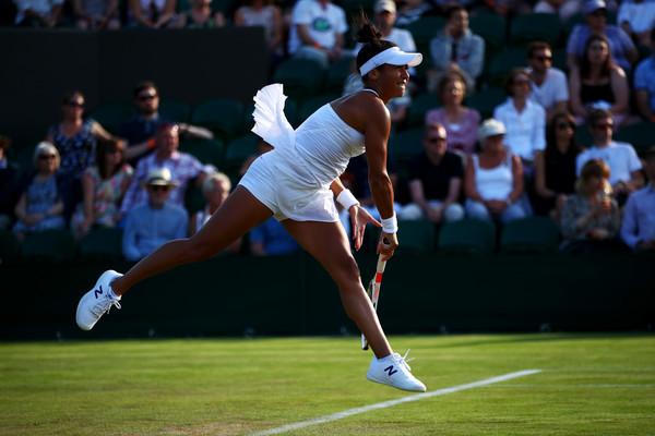 Heather Watson serves at the Wimbledon Championships