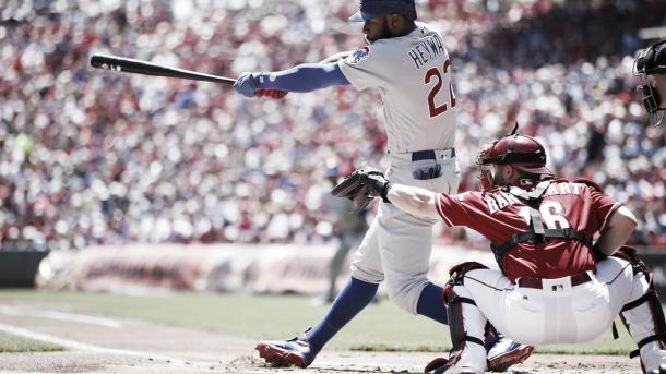 Jason Heyward singles to drive in a run against the Reds in the first inning (Joe Robbins/Getty Images)