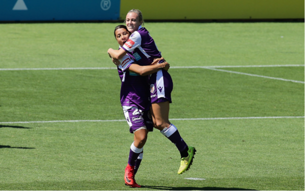 Forward Rachel Hill is lifted by forward Samantha Kerr after scoring the first goal of the match for her squad (Perth Glory) | Photo: Will Russell - Getty Images
