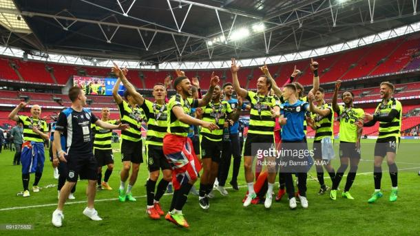 The Terriers celebrating their promotion at Wembley in May