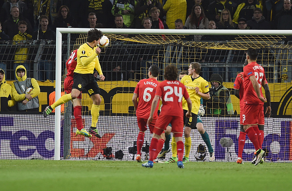Mats Hummels rises unmarked to head home his goal for Borussia Dortmund. (Getty)