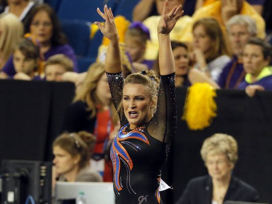 Bridget Sloan salutes after a stellar floor exercise at the NCAA Women's Gymnastics Championships/AP