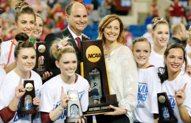 Oklahoma head coach KJ Kindler with her team after winning the NCAA Women's Gymnastics Championships/OU Sports