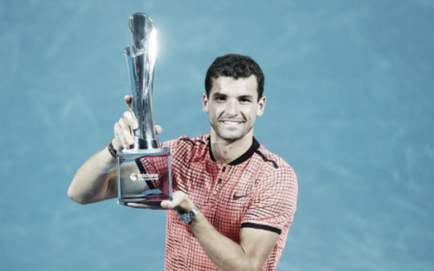 Dimitrov all smiles with his title in Brisbane (Chris Hyde/Getty Images)