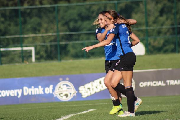 Lo'eau LaBonta and Shea Groom celebrate a goal against Sky Blue FC on September 3 | Source: Cindy Lara - VAVEL USA