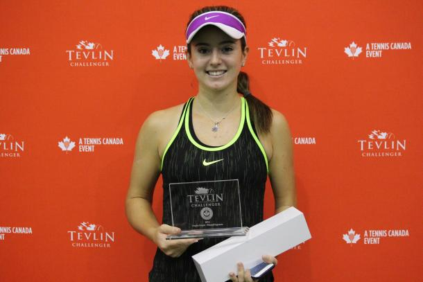 Catherine Bellis poses with the winner's trophy after defeating Jesika Maleckova in the final of the 2016 Tevlin Challenger. | Photo: Max Gao