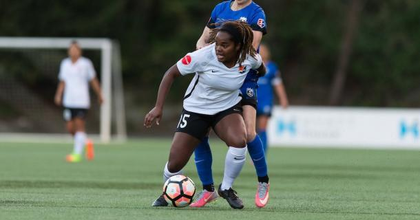 Defender Kayla Mills fighting to clear the ball | Source: Sky Blue FC