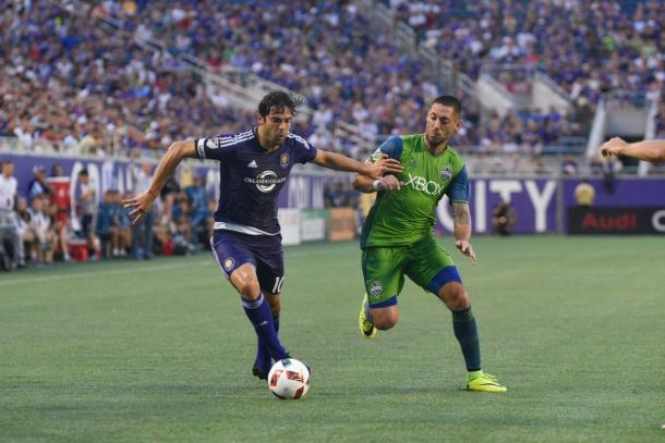 Kaka (left) and Clint Dempsey (right) battle for possession. (Photo: Nick Leyva - The Mane Land)