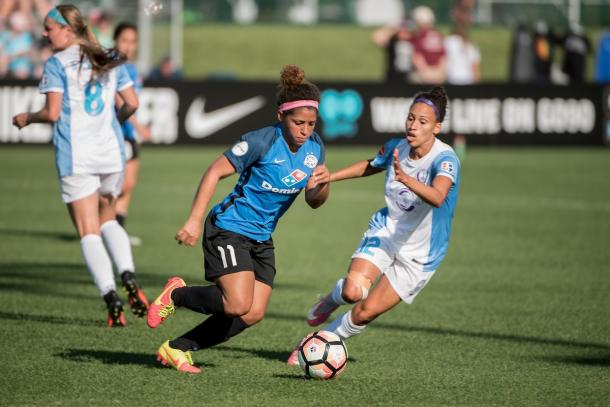 Midfielder Desiree Scott (center) as she attempts to get by Orlando Pride midfielder Kristen Edmonds | Source: FC Kansas City