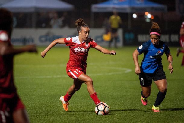 Mallory Pugh attempts to get past midfielder Desiree Scott | Source: Washington Spirit