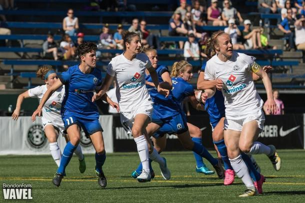Defender Becky Sauerbrunn (far right) as she holds down the back line to prevent Seattle Reign from scoring | Source: Brandon Farris - VAVEL USA