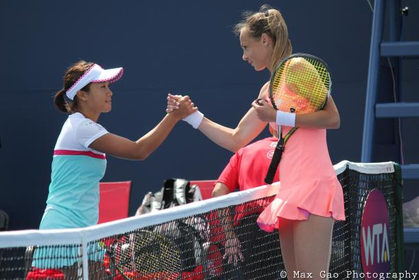 Kurumi Nara (L) and Magdalena Rybarikova shake hands after their thrilling first-round qualifying match at the 2017 Rogers Cup presented by National Bank. | Photo: Max Gao