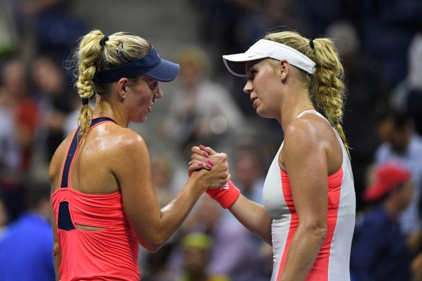 Angelique Kerber (L) shakes hands with Caroline Wozniacki (R) after their semifinal match at the US Open.(Photo: Garrett Ellwood/USTA)