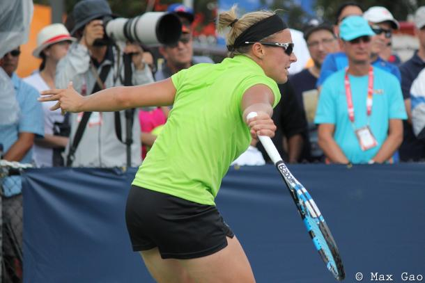 Kirsten Flipkens hits one of her signature backhand slices during her final-round qualifying match at the 2017 Rogers Cup presented by National Bank. | Photo: Max Gao