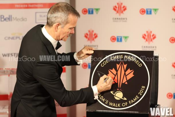 Chris Hadfield signs his star on Canada's Walk of Fame, which is just another award on a long list of extraordinary awards and accolades for the retired astronaut.