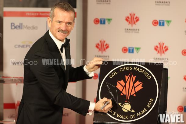 Say cheese! Chris Hadfield poses for a picture with his star on Canada's Walk of Fame.