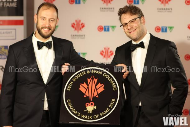 Evan Goldberg and Seth Rogen pose with their star on Canada's Walk of Fame.