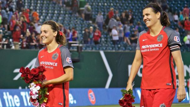 Raso and Sinclair celebrate with Thorns' fans. Photo: Craig Mitchelldyer
