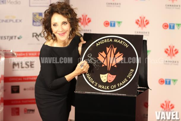Andrea Martin poses for a photo while signing her star.