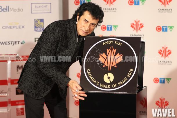 Say cheese! Montreal-born singer-songwriter Andy Kim poses with his star on Canada's Walk of Fame.
