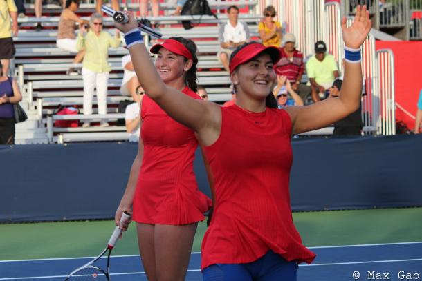 The future of Canadian tennis: Canadians Carson Branstine and Bianca Andreescu wave to the crowd after their thrilling three-set victory over Kristina Mladenovic and Anastasia Pavlyuchenkova in the first round of the 2017 Rogers Cup. | Photo: Max Gao