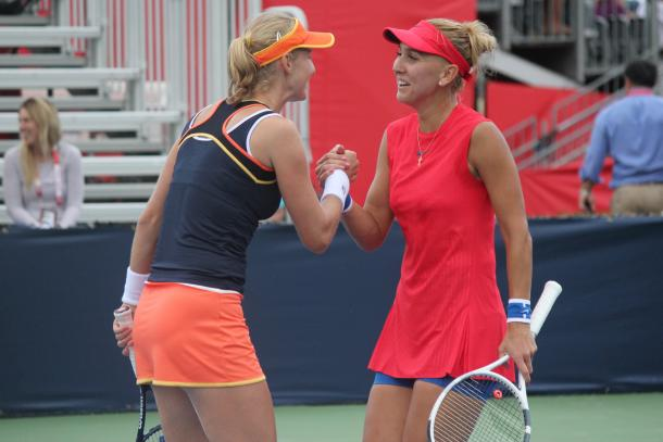 Ekaterina Makarova and Elena Vesnina greet each other after their second-round victory over Bianca Andreescu and Carson Branstine at the 2017 Rogers Cup presented by National Bank. | Photo: Max Gao