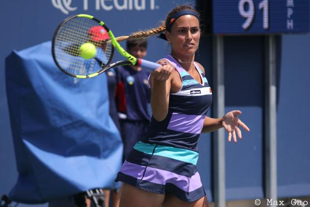 Monica Puig hits a forehand during her final-round qualifying match at the 2017 Western & Southern Open. | Photo: Max Gao