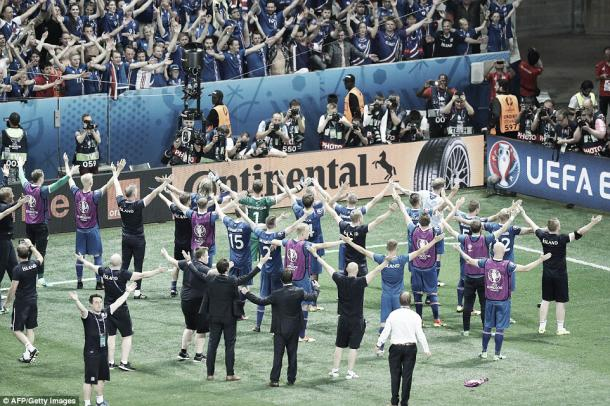Above: Iceland players and staff celebrating their 2-1 win over England | Photo: AFP/Getty Images