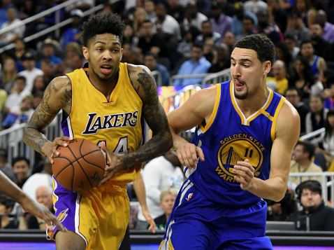 Brandon Ingram (left) drives to the basket as Klay Thompson tries to stop him | Source: Ethan Miller - Getty Images