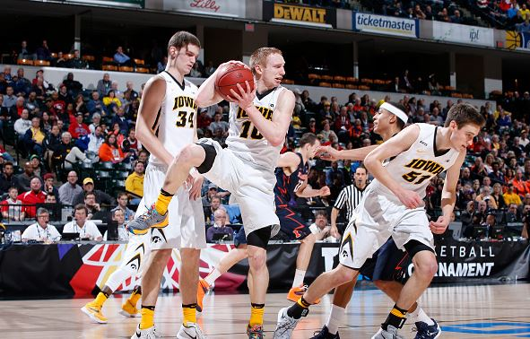 Mike Gesell #10 of the Iowa Hawkeyes grabs a rebound against the Illinois Fighting Illini in the second round of the Big Ten Basketball Tournament at Bankers Life Fieldhouse on March 10, 2016 in Indianapolis, Indiana. (Photo by Joe Robbins/Getty Images