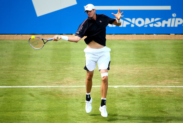 John Isner crushes a forehand during his first round win. Photo; Jordan Mansfield/Getty Images
