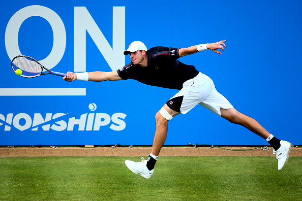 John Isner lunges for a forehand during his first round win in London. Photo: Jordan Mansfield/Getty Images