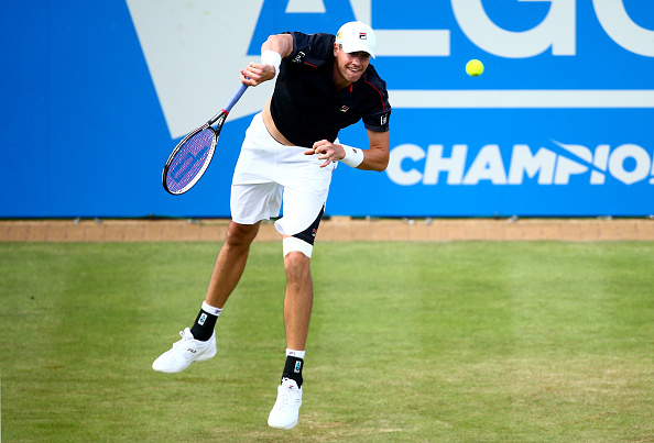 John Isner hits a serve during his first round match at the Queen's Club. Photo: Jordan Mansfield/Getty Images