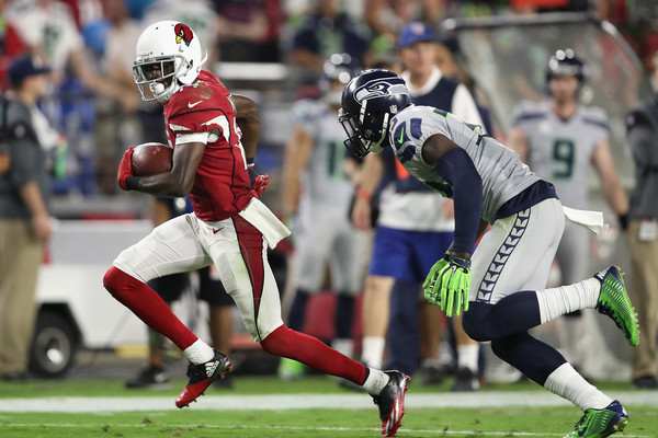 Wide receiver J.J. Nelson #14 of the Arizona Cardinals runs with the football after a reception against the Seattle Seahawks  |Oct. 22, 2016 - Source: Christian Petersen/Getty Images North America|