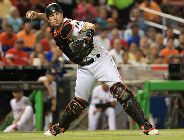 J.T. Realmuto #11 of the Miami Marlins makes a throw to first during a game against the Washington Nationals. |June 19, 2017 - Source: Mike Ehrmann/Getty Images North America|