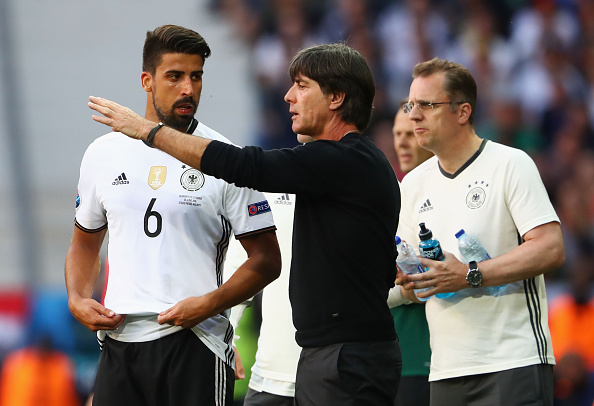 Löw talks Sami Khedira through the next phase of play. | Image credit: Alexander Hassenstein/Getty Images