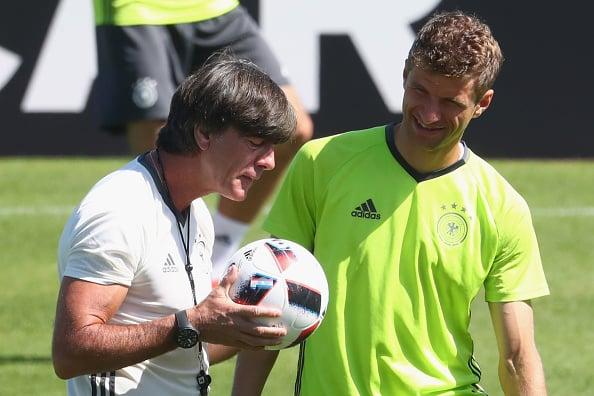 The coach jokes around during training. | Image credit: Alexander Hassenstein/Getty Images