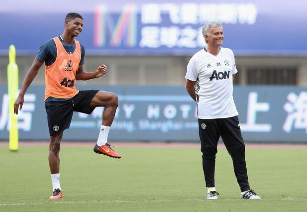 Marcus Rashford (left) and José share a joke during a United training session.