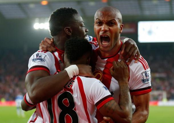 Sunderland's Lamine Kone (left) celebrates scoring with Younes Kaboul and Jermain Defoe. | Photo: The Chronicle Live
